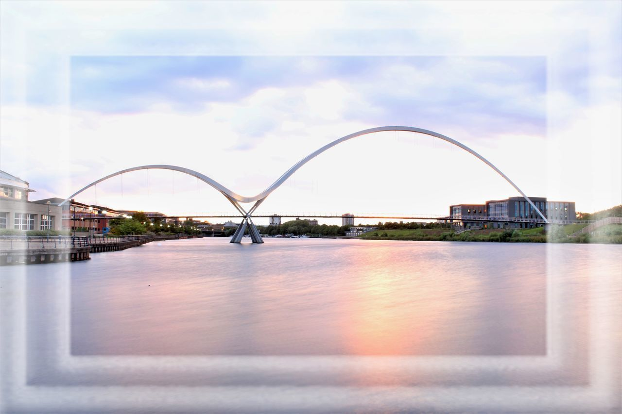 Arch Architecture Bridge - Man Made Structure Building Exterior Built Structure City Cloud - Sky Day Infinity Bridge Nature No People Outdoors Reflection Sky Water Waterfront