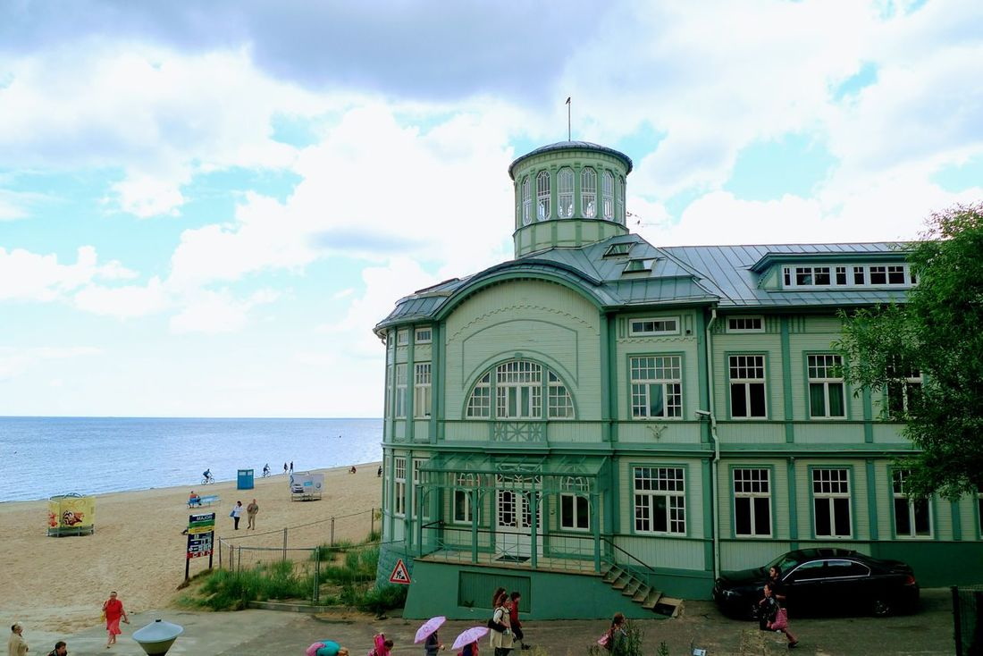 Former spa Emilija Racene at the beach of Jurmala in Latvia, Balticum Cloud - Sky Sky Travel Destinations Building Exterior Architecture 1911 Outdoors Day People Architecture Wooden Wooden House Beach Summer Tourism Tourist Attraction  Sand Beach Latvia Baltic Sea Baltic Countries Baltic Coast Spa