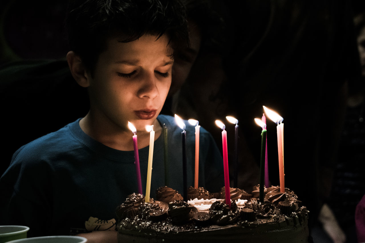 Birthday Birthday Cake Birthday Candles Boys Burning Candle Celebration Child Childhood Close-up Dark Domestic Life Flame Human Body Part Igniting Indoors  Males  One Boy Only One Person People Teenager