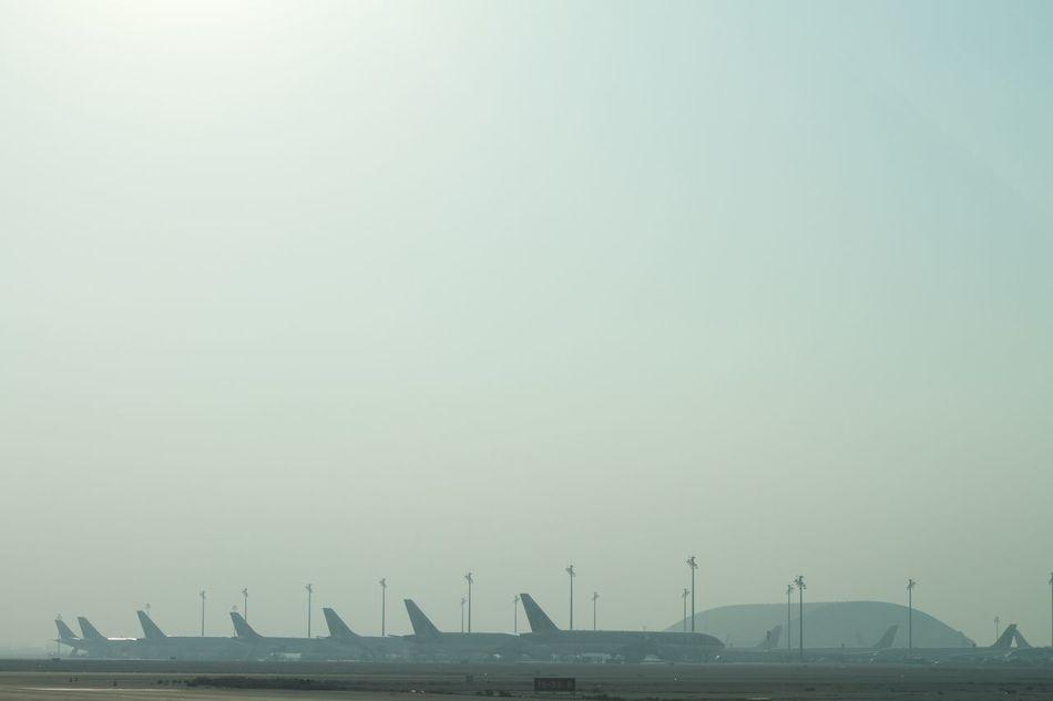 Airport Aviation Built Structure Dawn Day Doha Doha International Airport (doh) مطار الدوحة الدولي Haze No People Outdoors Sky Terminal EyeEmNewHere