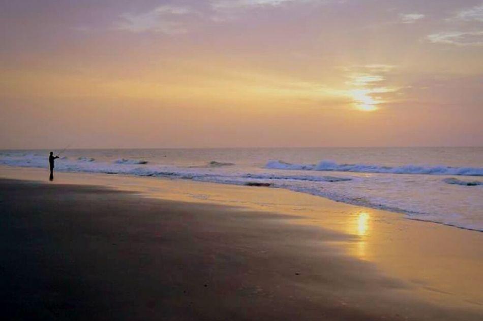 Early morning fisherman Early Morning Sunrise Fisherman Serene Peaceful Beachphotography Beach Clouds
