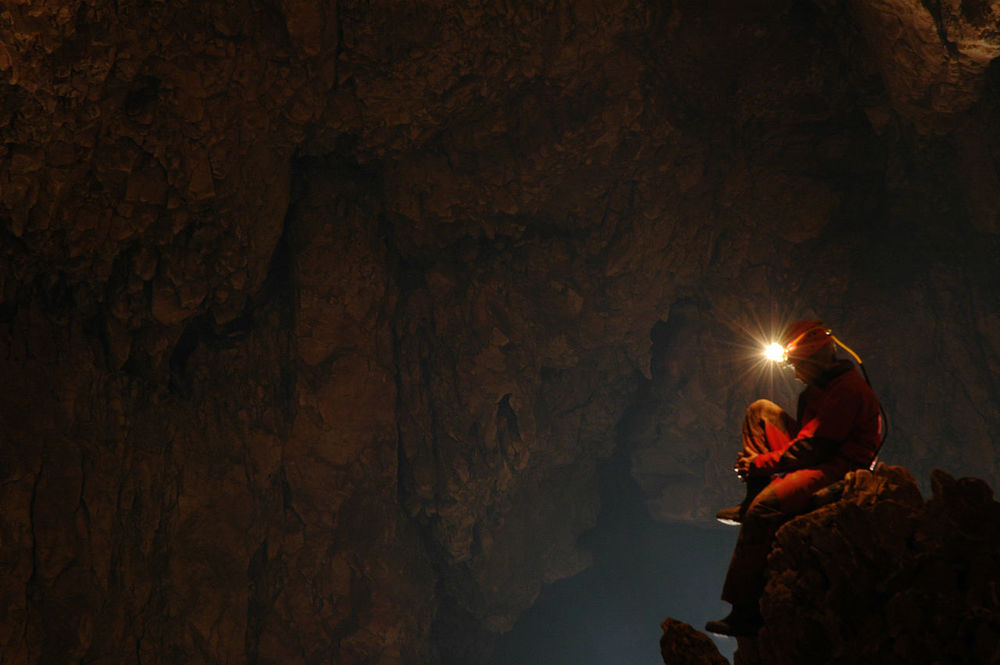 Spelunker exploring a cave Archeology Catacomb Cave Cavern Caves Caves Photography Dark Discovery Explorer Exploring Geological Formation Geology Grotto Helmet Light Mountain Nature Realm Speleo Speleology Spelunkers Spelunking Sport Spéléologie Underground Fresh On Market 2016