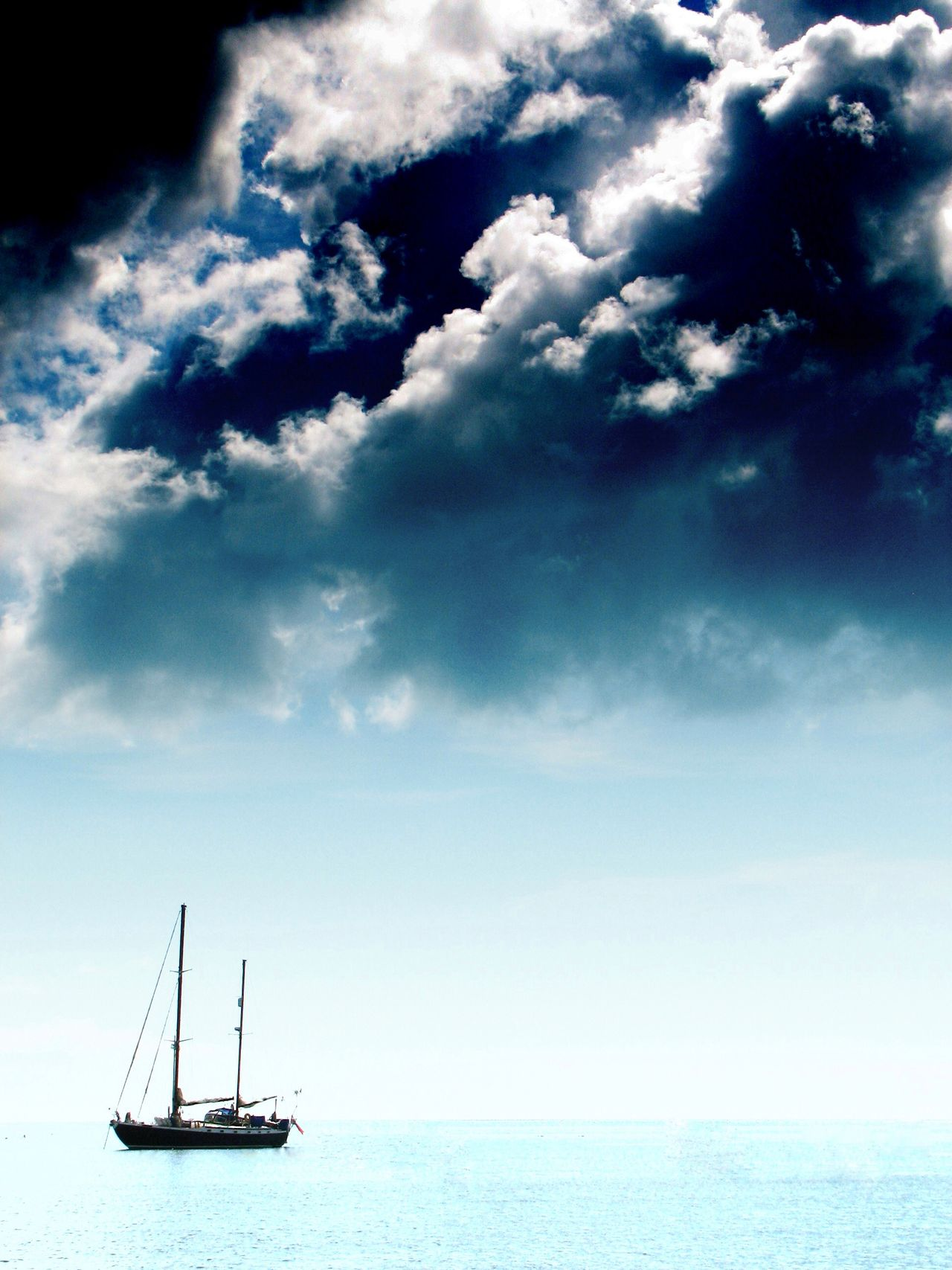 Ship Clouds Alone Peaceful Sea Ocean Solitude Ice Dark Clouds Black Clouds Looming Contrast Boat Float Lost Cold White Hopeless Helpless Calm The Calmness Within Foreboding Sailing Sailboat Panic