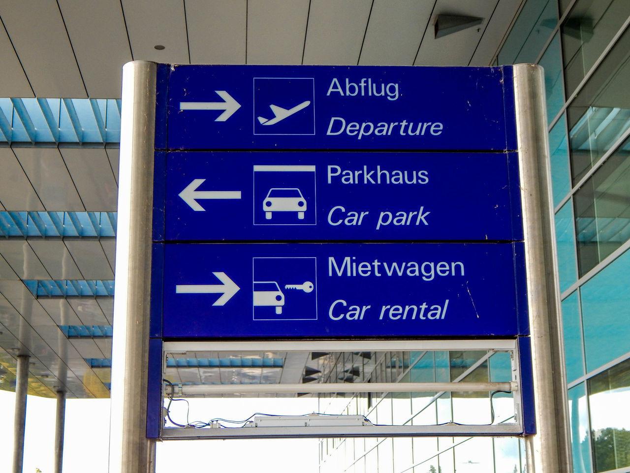 Abflug Airport Ankunft Arrival Departure Board Blue Car Rental Flug Guidance Hinweis Information Sign Journey Low Angle View Mietwagen No People Outdoors Parken Schild Text Transportation Travel