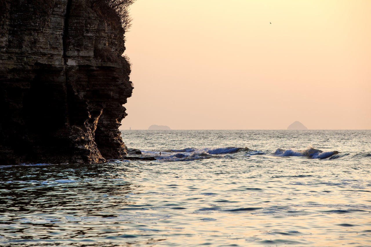 Beauty In Nature Byunsan Chaeseokgang Cliff Coastline Day Geology Horizon Over Water Nature Ocean Outdoors Physical Geography Power In Nature Rippled Rock Rock - Object Rock Formation Rocky Rough Sea Seascape Sunset Surge Vacations Water