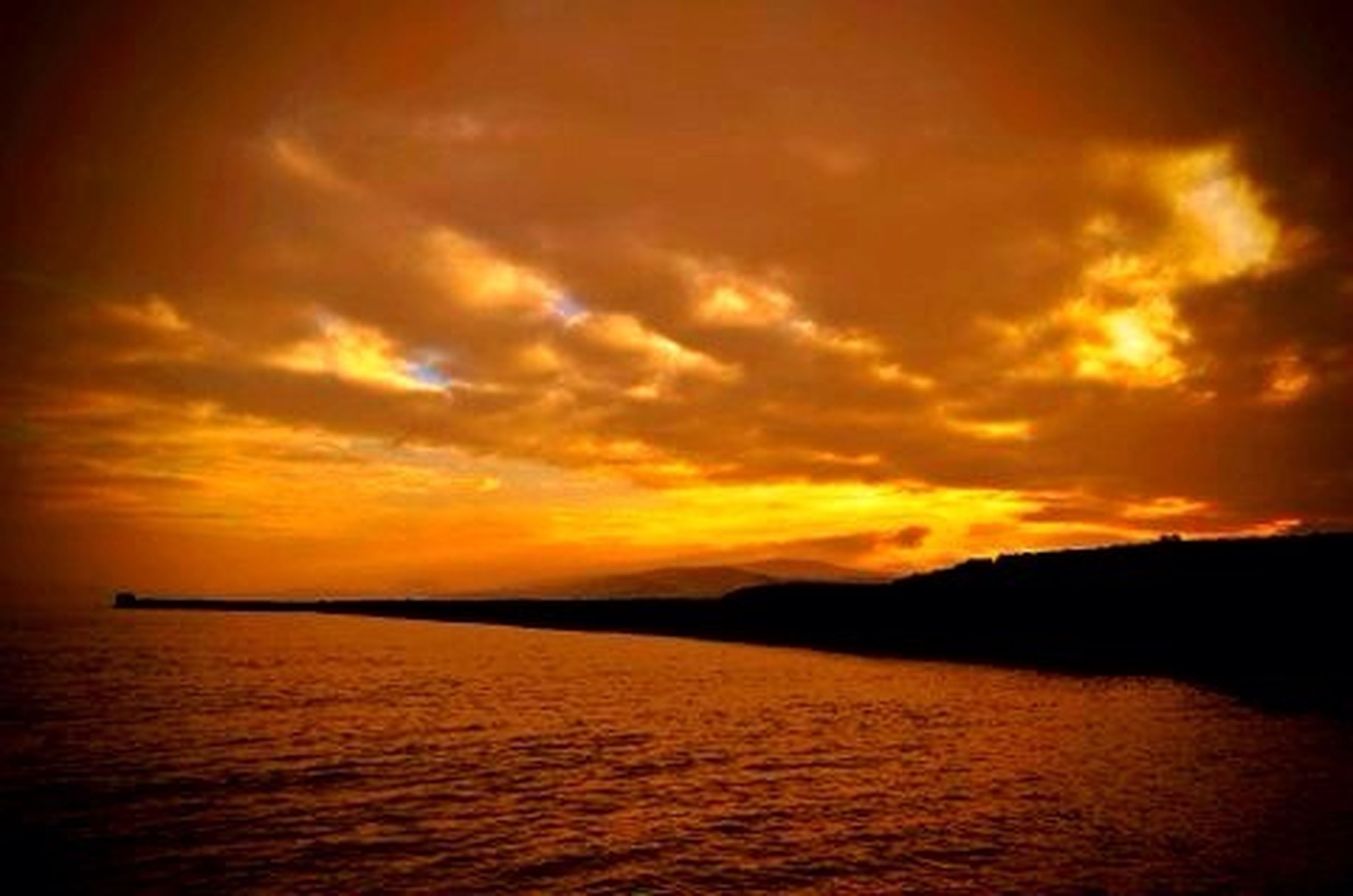 sunset, water, sea, scenics, tranquil scene, beauty in nature, orange color, tranquility, sky, waterfront, idyllic, horizon over water, nature, cloud - sky, silhouette, cloud, reflection, outdoors, dramatic sky, rippled