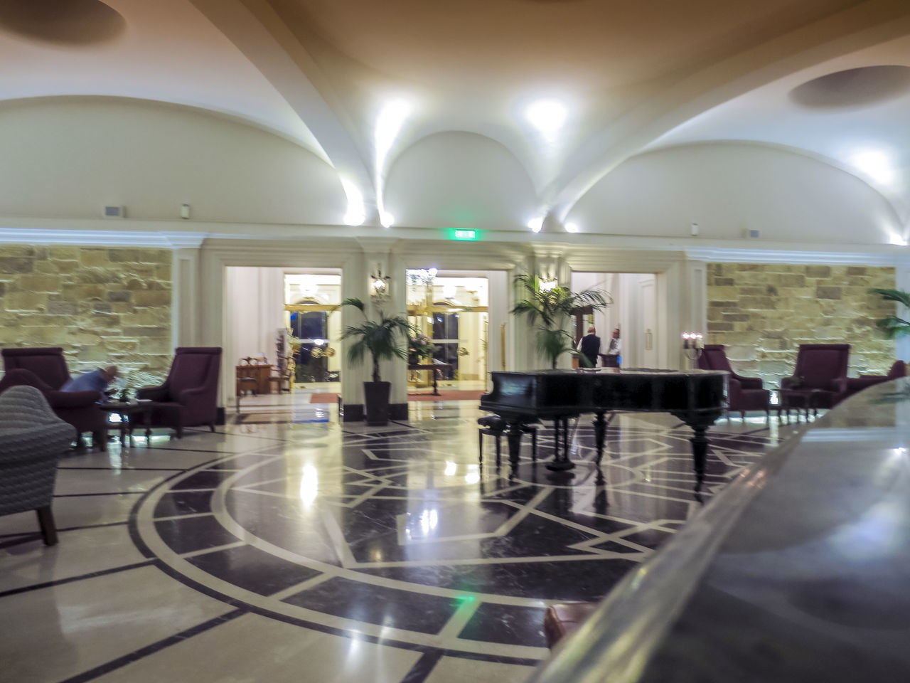 indoors, arch, ceiling, architecture, travel, chair, luxury, illuminated, architectural column, luxury hotel, seat, built structure, real people, modern, day