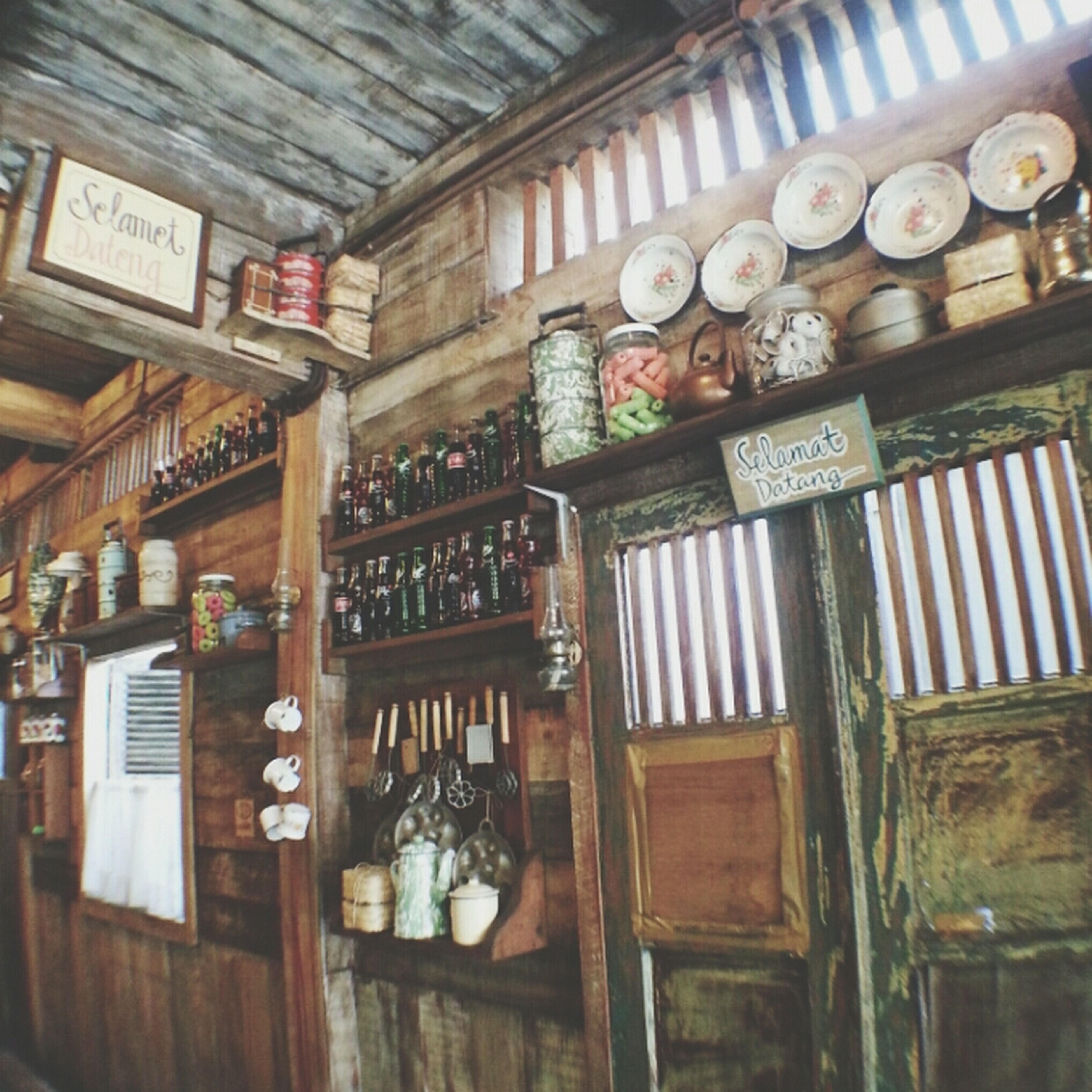indoors, text, wood - material, western script, communication, window, architecture, old, no people, non-western script, shelf, built structure, hanging, low angle view, door, glass - material, number, house, old-fashioned, wooden