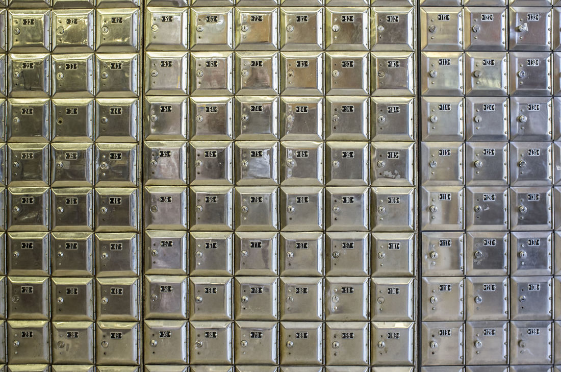 Wall full of rows of old shiny metal post office boxes Abundance Alphabet Arrangement Backgrounds Close-up Computer Key Day Full Frame In A Row Indoors  Large Group Of Objects No People Repetition
