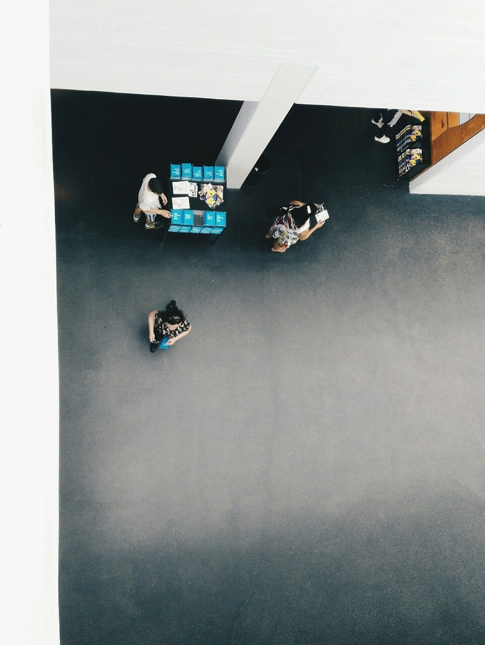 High Angle View Of People Walking Indoors