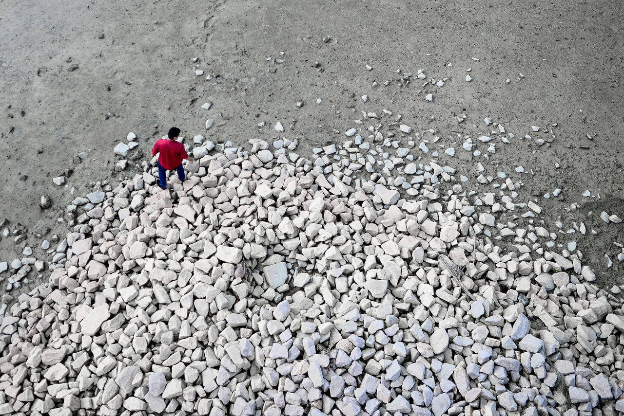Alone Background Beach Day Nature One Person Outdoors Pebble Pebble Beach Red And White View From Above Walking Break The Mold