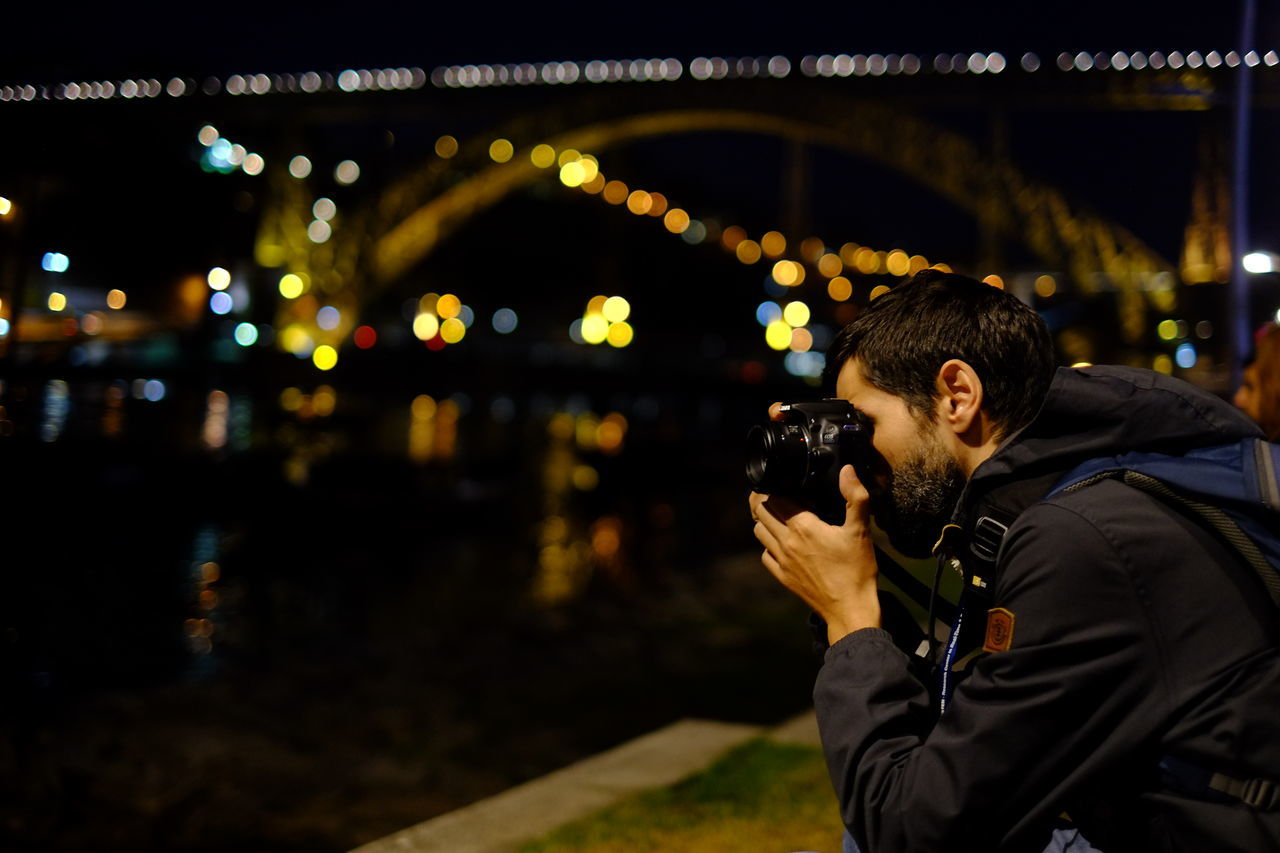 Adult Adults Only Bridge Bridge - Man Made Structure Business Finance And Industry Businessman Camera - Photographic Equipment City Communication Connection Digital Camera Focus On Foreground Holding Illuminated Men Night One Man Only One Person Only Men Outdoors People Photographer Photographing Photography Themes Technology