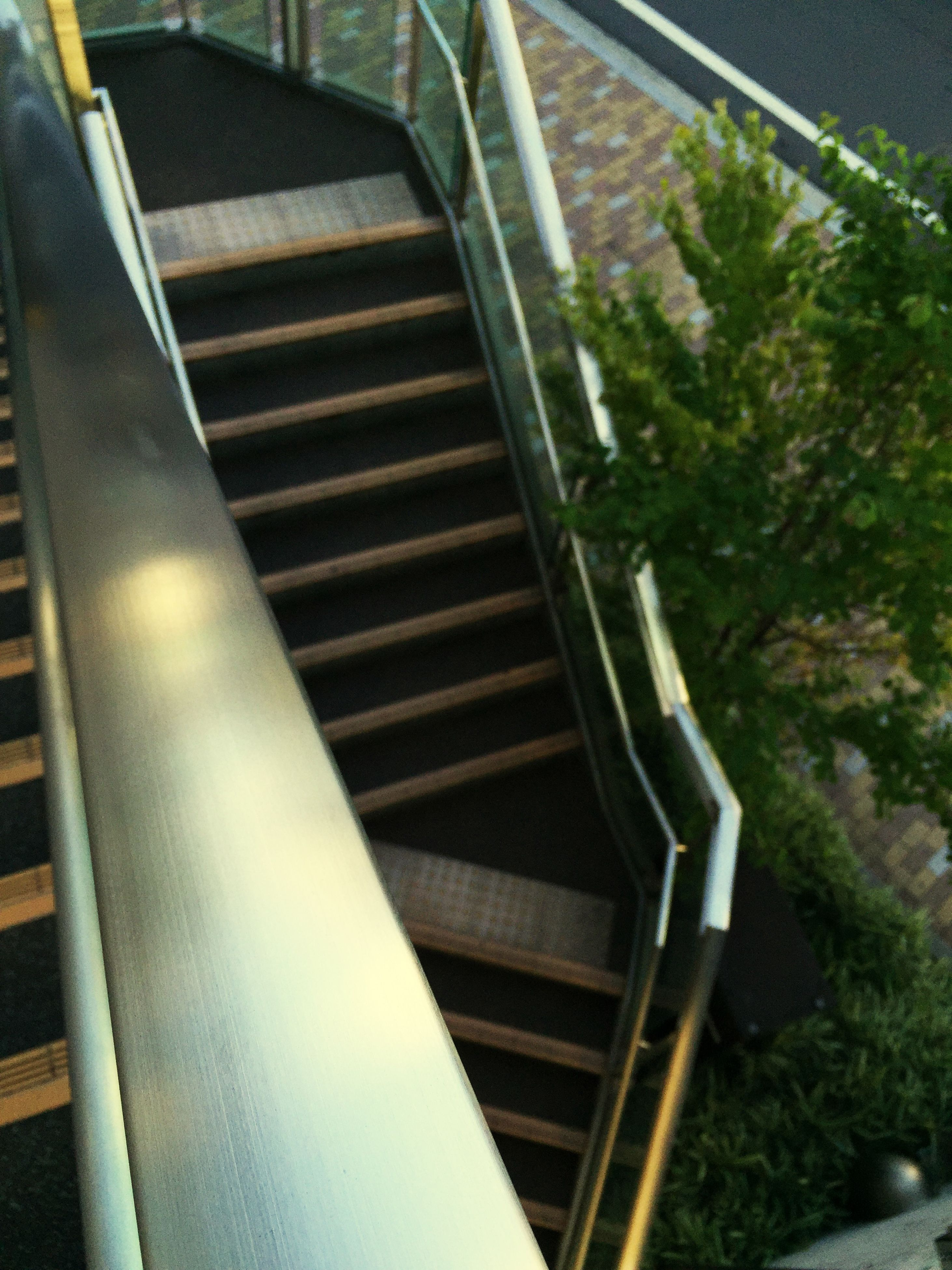 steps, steps and staircases, staircase, railing, indoors, metal, high angle view, escalator, transportation, stairs, no people, built structure, sunlight, day, absence, empty, the way forward, rail transportation, close-up, architecture