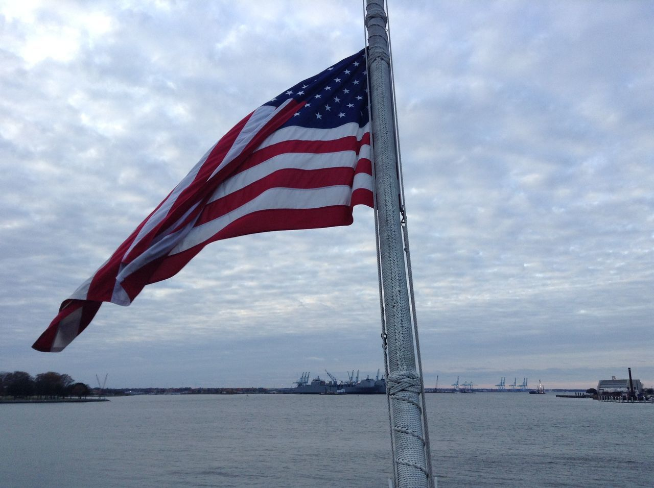 patriotism, flag, striped, stars and stripes, sky, cloud - sky, flag pole, freedom, day, no people, outdoors, red, water, nature