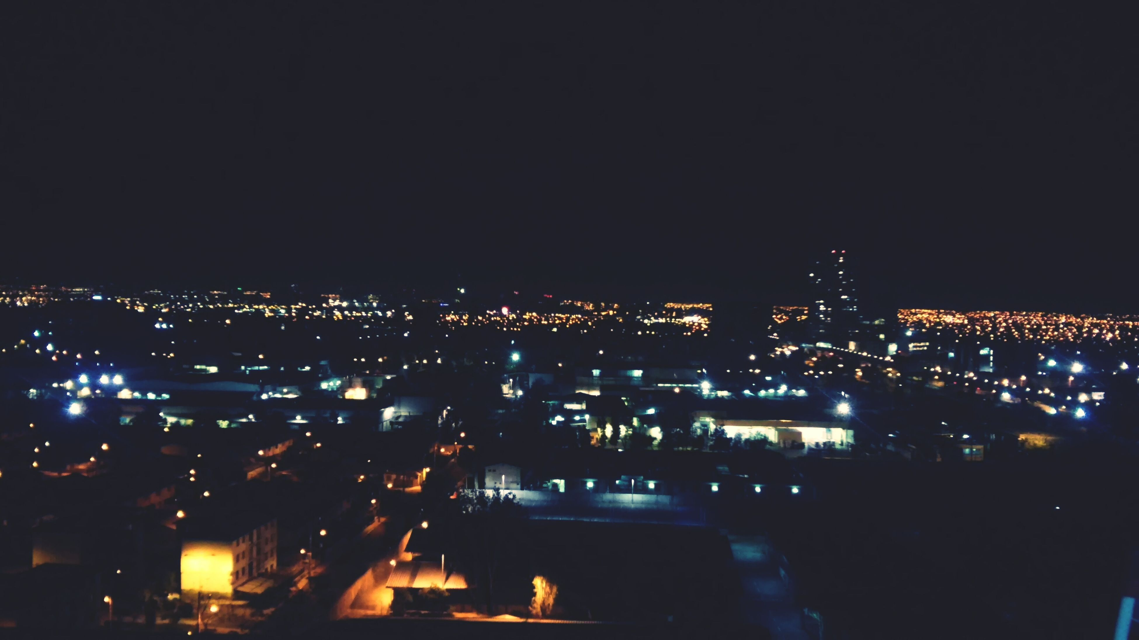 illuminated, night, cityscape, city, building exterior, architecture, built structure, crowded, copy space, dark, high angle view, clear sky, residential district, residential building, skyscraper, city life, residential structure, modern, sky, light