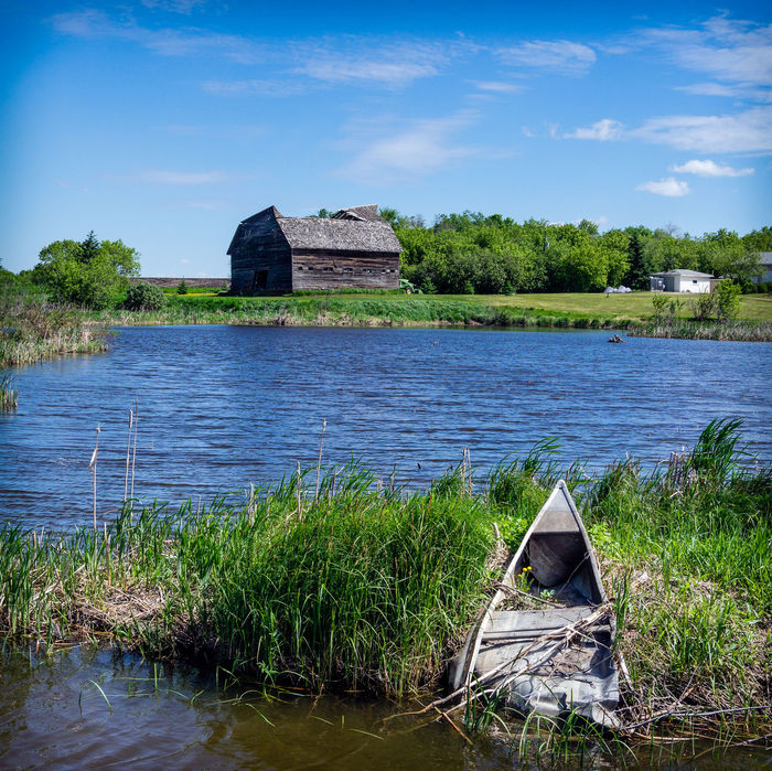 Barn Ancient Civilization Architecture Beauty In Nature Botany Building Exterior Built Structure Cloud - Sky Day Grass History Lake Nature No People Old Ruin Outdoors Scenics Sky The Past Tranquility Travel Destinations Tree Water