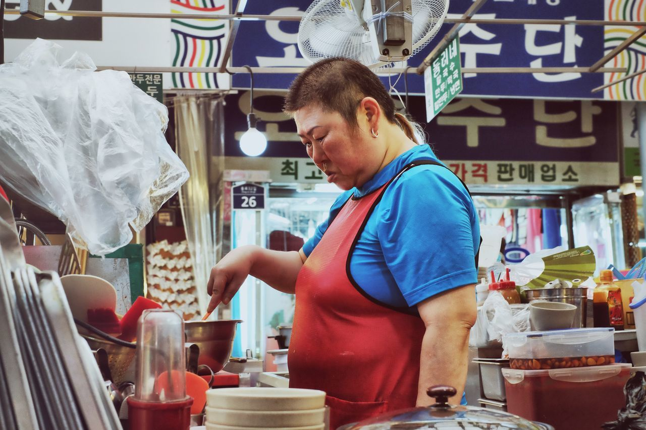 Market-Woman at the Gwangjang Market (광장시장) Apron Casual Clothing Choice Cooking Cookshop Eating Food Food And Drink Food Stand Foodporn For Sale Freshness Freshness Kitchen Leisure Activity Portrait Photography Market Market Market Stall Market-woman Retail  Sitting Small Business Store Portrait Of A Woman
