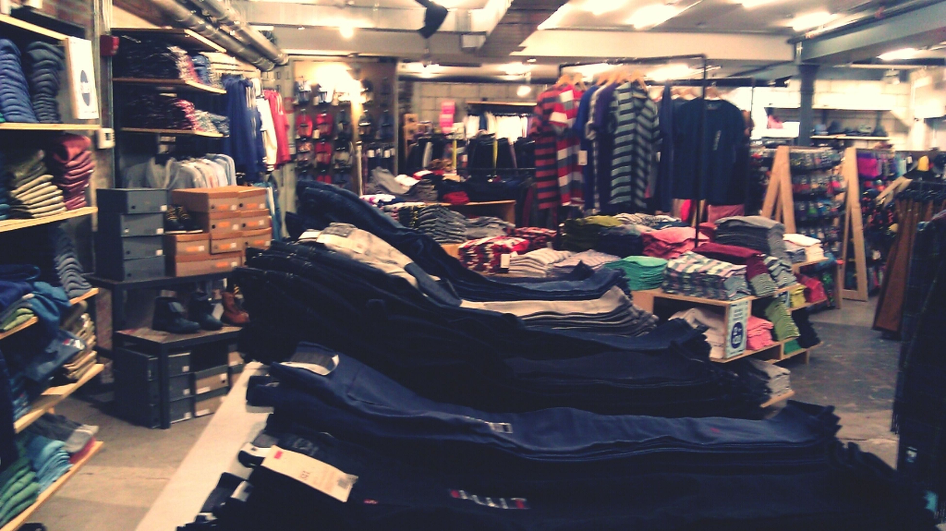 indoors, retail, for sale, store, market, large group of objects, abundance, shopping, choice, market stall, variation, men, in a row, arrangement, small business, incidental people, chair, shop, business