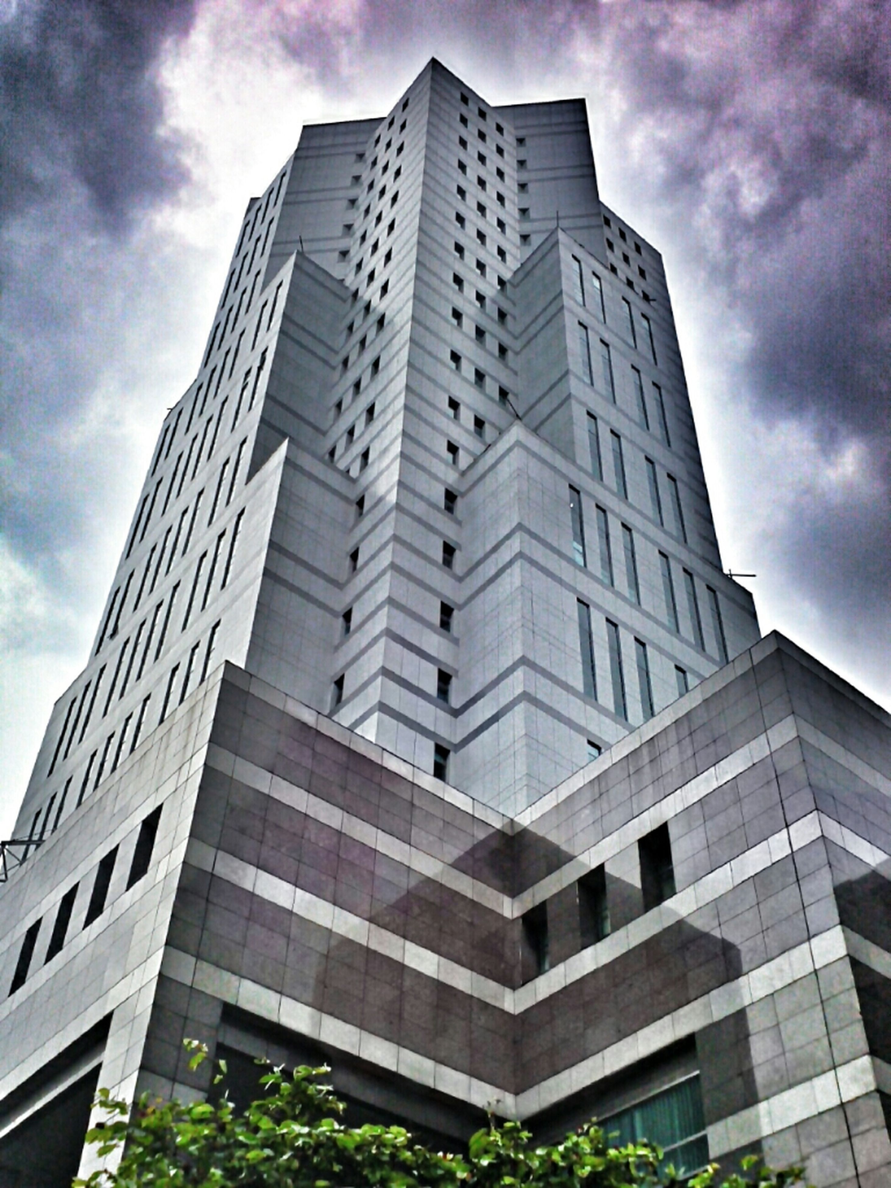 building exterior, architecture, low angle view, built structure, modern, sky, office building, skyscraper, city, tall - high, cloud - sky, tower, glass - material, building, cloudy, tall, reflection, cloud, window, day