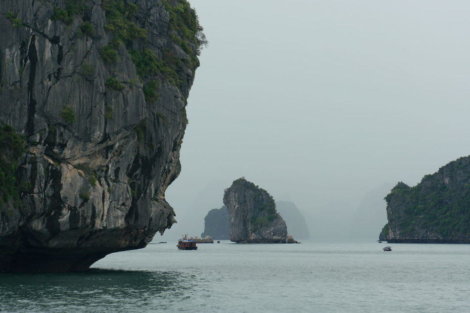 Boats And Water Boats In The Distance Fog Foggy Morning Halong Bay Vietnam UNESCO World Heritage Site Vessels In Fog Vietnam, Halong Bay TakeoverContrast