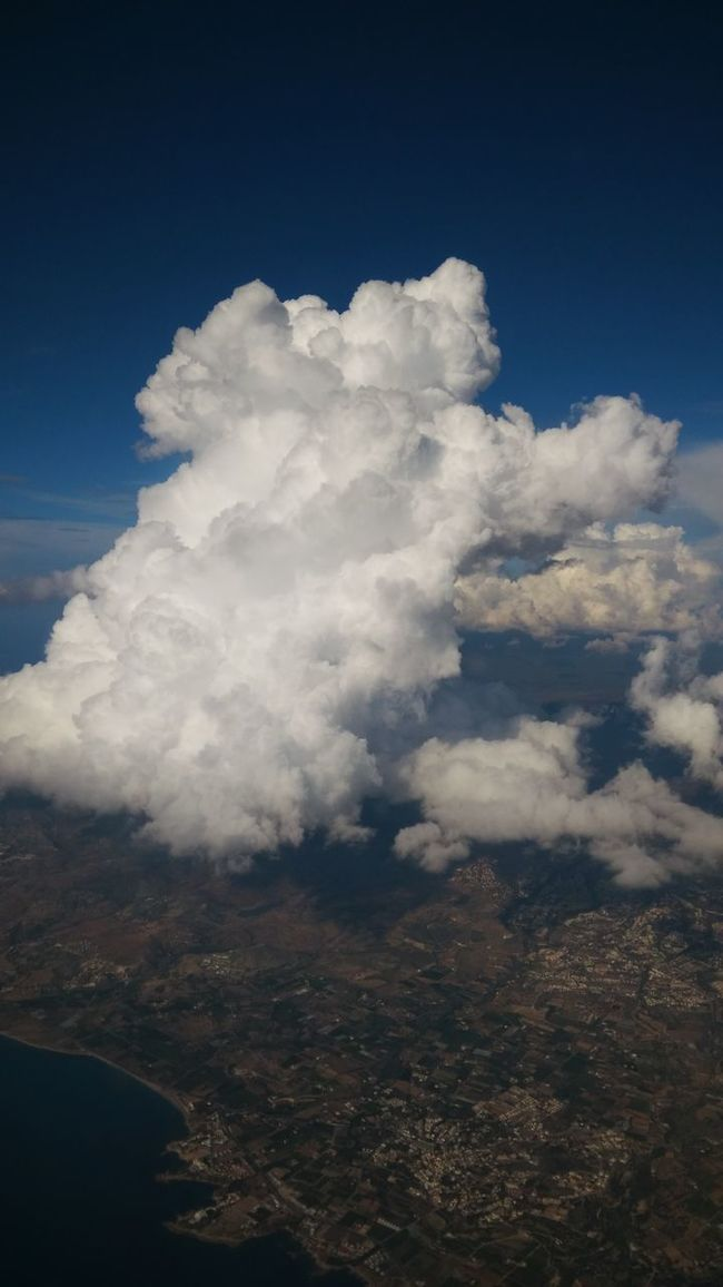 what do you see in this photo? From An Airplane Window Clouds And Sky Cloudporn Aerial Shot Landscapes With WhiteWall