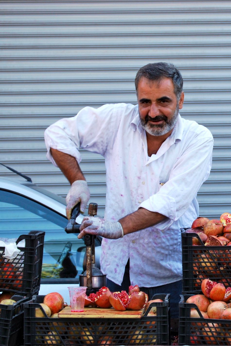 A man in Istanbul preparing a fresh glass of pomegranate juice Food And Drink Handmade Istanbul Juice Juice Press Juice Press Looking At Camera Natural Viagra Pomegranate Turkey