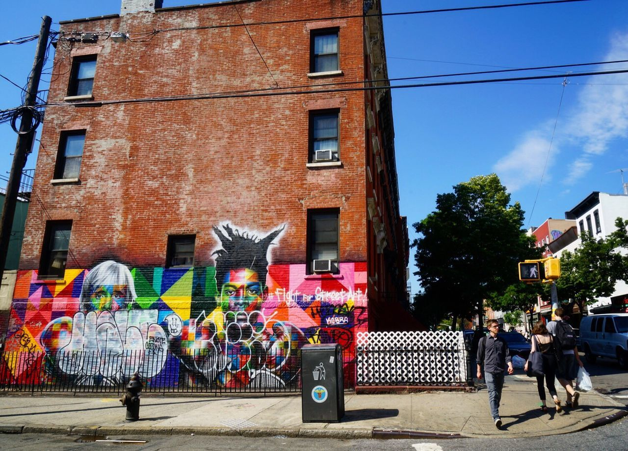 Building Exterior Architecture Built Structure Multi Colored City Tourism Travel Destinations Tourist Colorful Blue Sky Day Outdoors In Front Of City Life New York Graffiti Modern