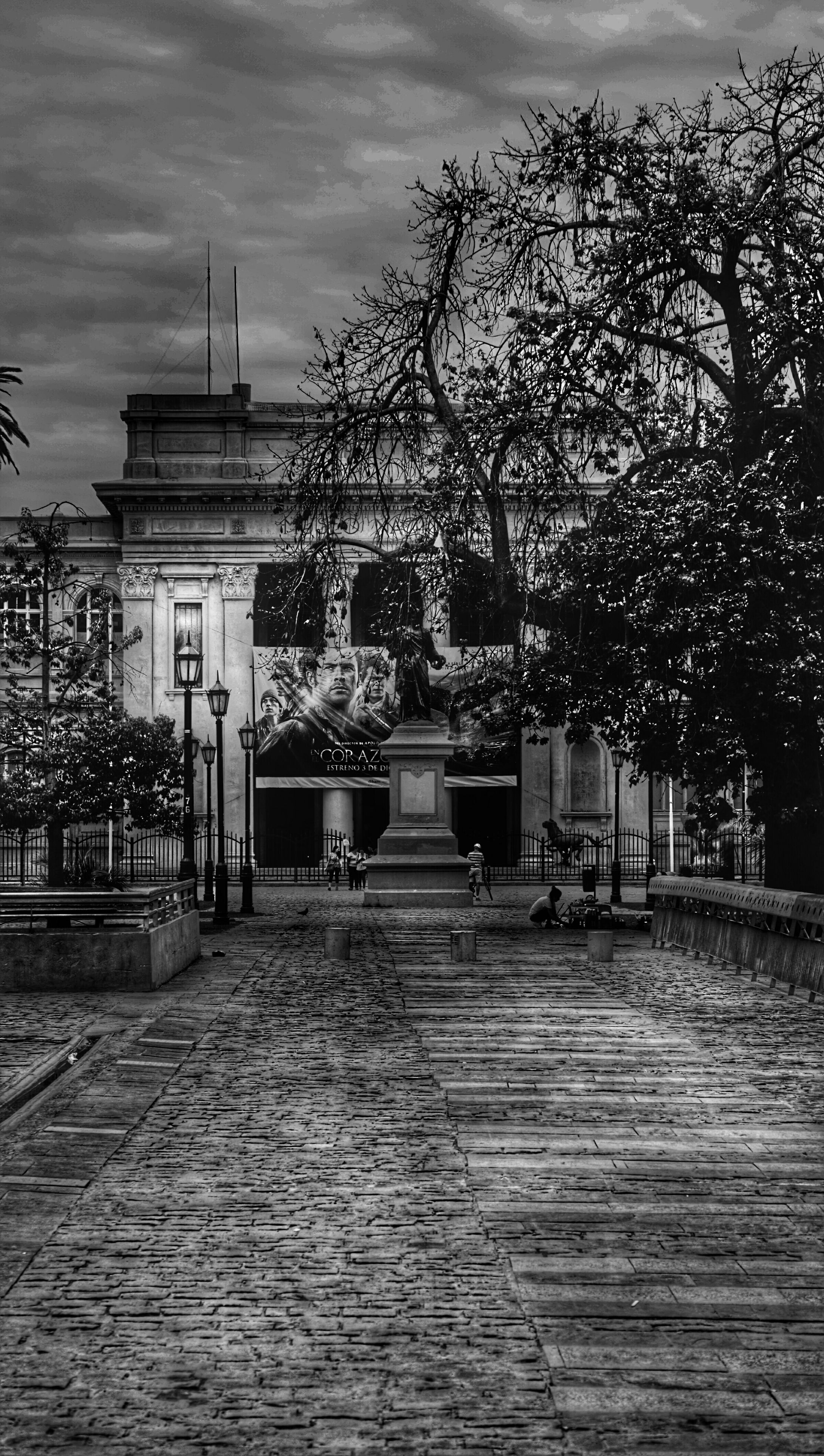 architecture, built structure, building exterior, tree, sky, cobblestone, the way forward, place of worship, religion, day, outdoors, entrance, footpath, gate, facade, architectural column, spirituality, steps, walkway, house