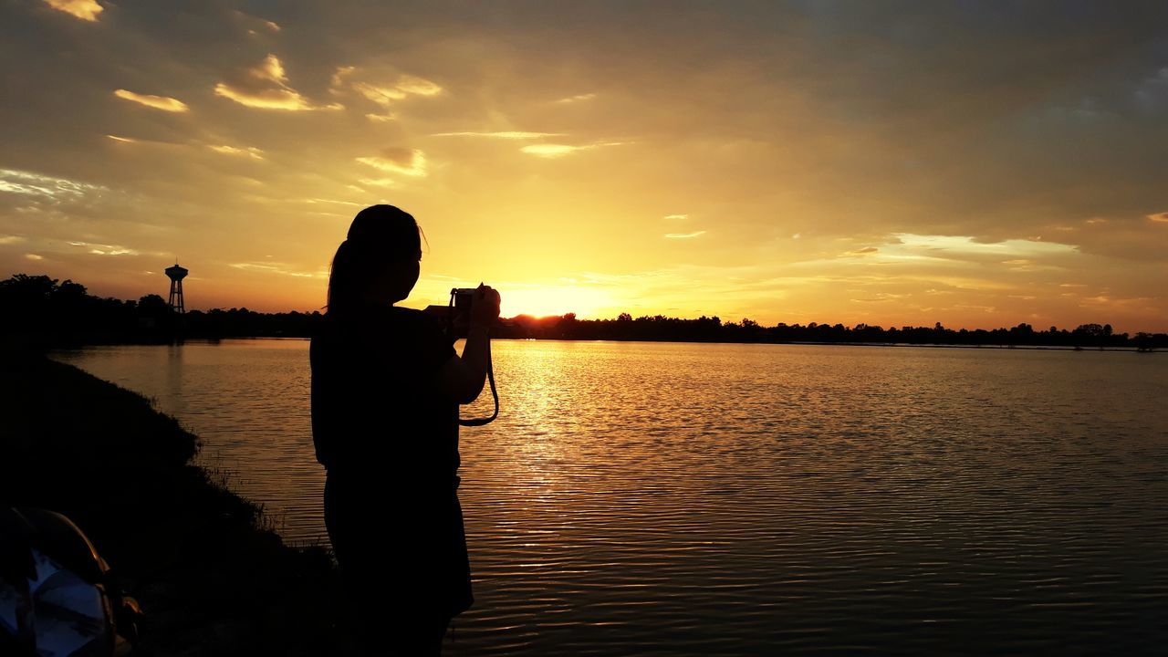 sunset@บึงแท่น2 Sunset Water Reflection One Person Silhouette Sky People Photographing Leisure Activity Lake Adult Outdoors Tranquility Cloud - Sky Photography Themes Nature One Man Only Men Only Men Tree