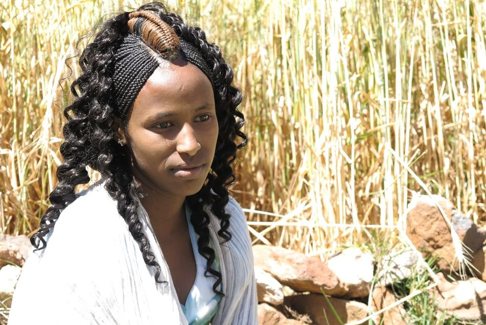 Adult Beautiful Woman Beauty Beauty In Nature Braided Hair Close-up Day Day Dreaming Ethiopia Field Hair Braiding Headshot Human Lips Nature One Person One Young Woman Only Outdoors People Portrait Summer Sunlight Sunset Watching Young Adult Young Women