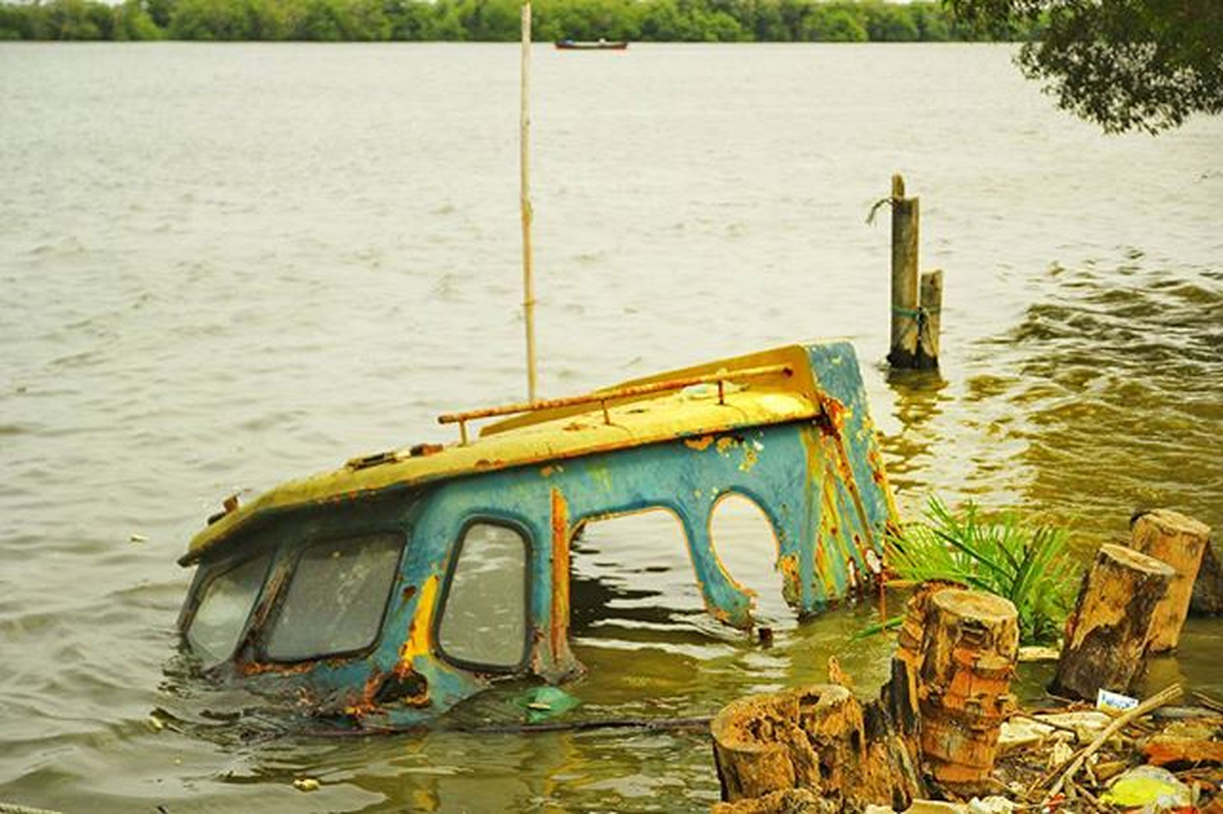 water, transportation, nautical vessel, mode of transport, boat, moored, lake, yellow, river, nature, day, outdoors, no people, wood - material, reflection, rippled, wooden post, tranquility, waterfront, abandoned