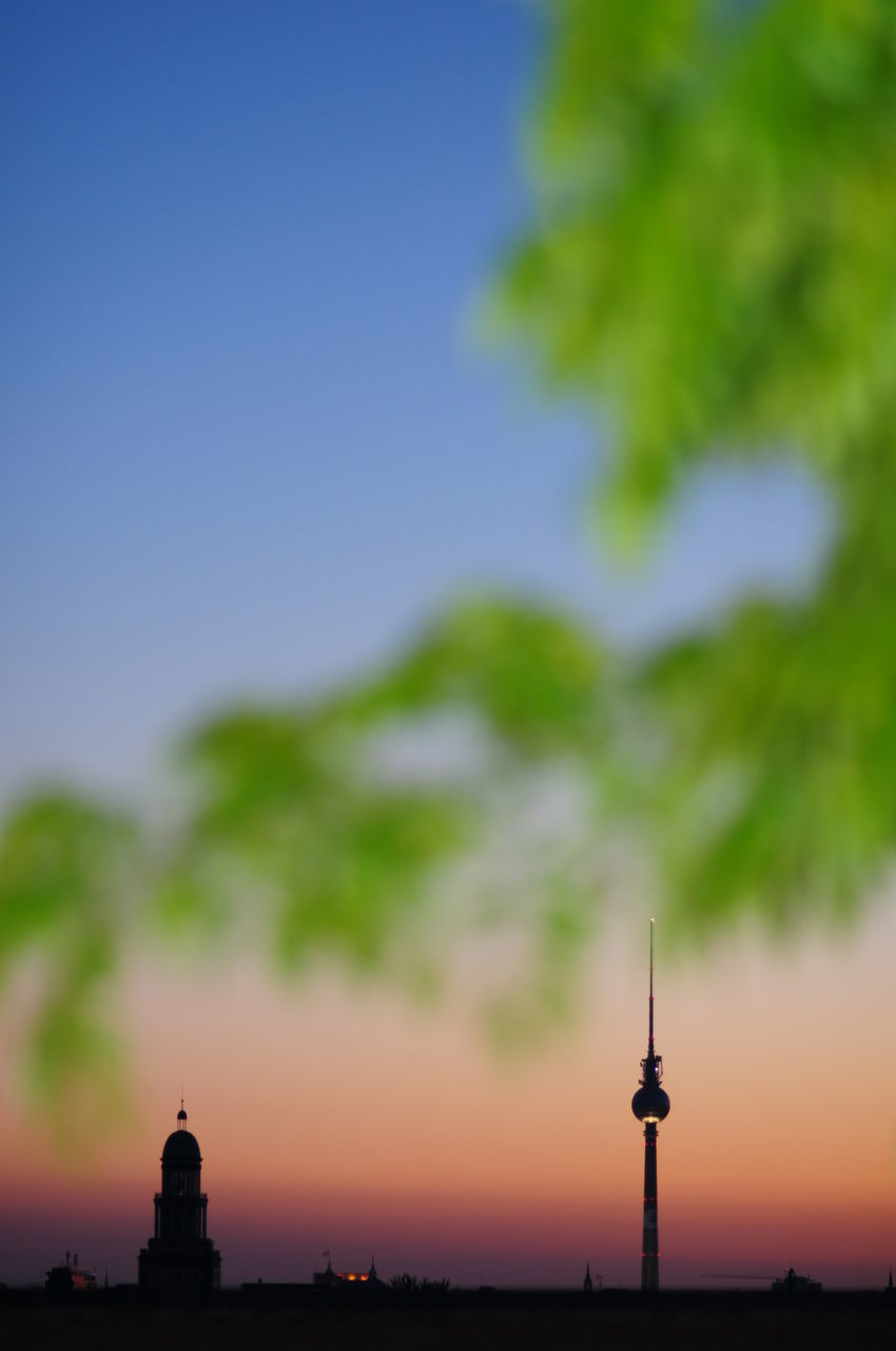 Illuminated Fernsehturm Against Sky During Sunset