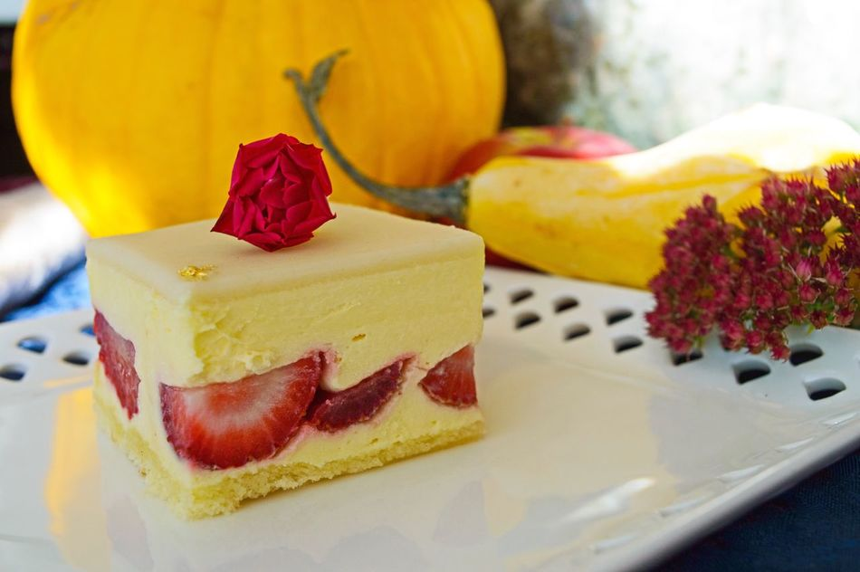 Fresh Strawberry Cream Cake with yellow pumpkins in the background Food Sweet Food Food And Drink Dessert Indulgence Cake Indoors  Ready-to-eat Freshness Temptation Autumn Rose Strawberry Cake Entertaining Dessert Decorated Fragility Autumn Fruits Still Life Close-up SLICE Selective Focus Fruit Pastry Serving Size Plate