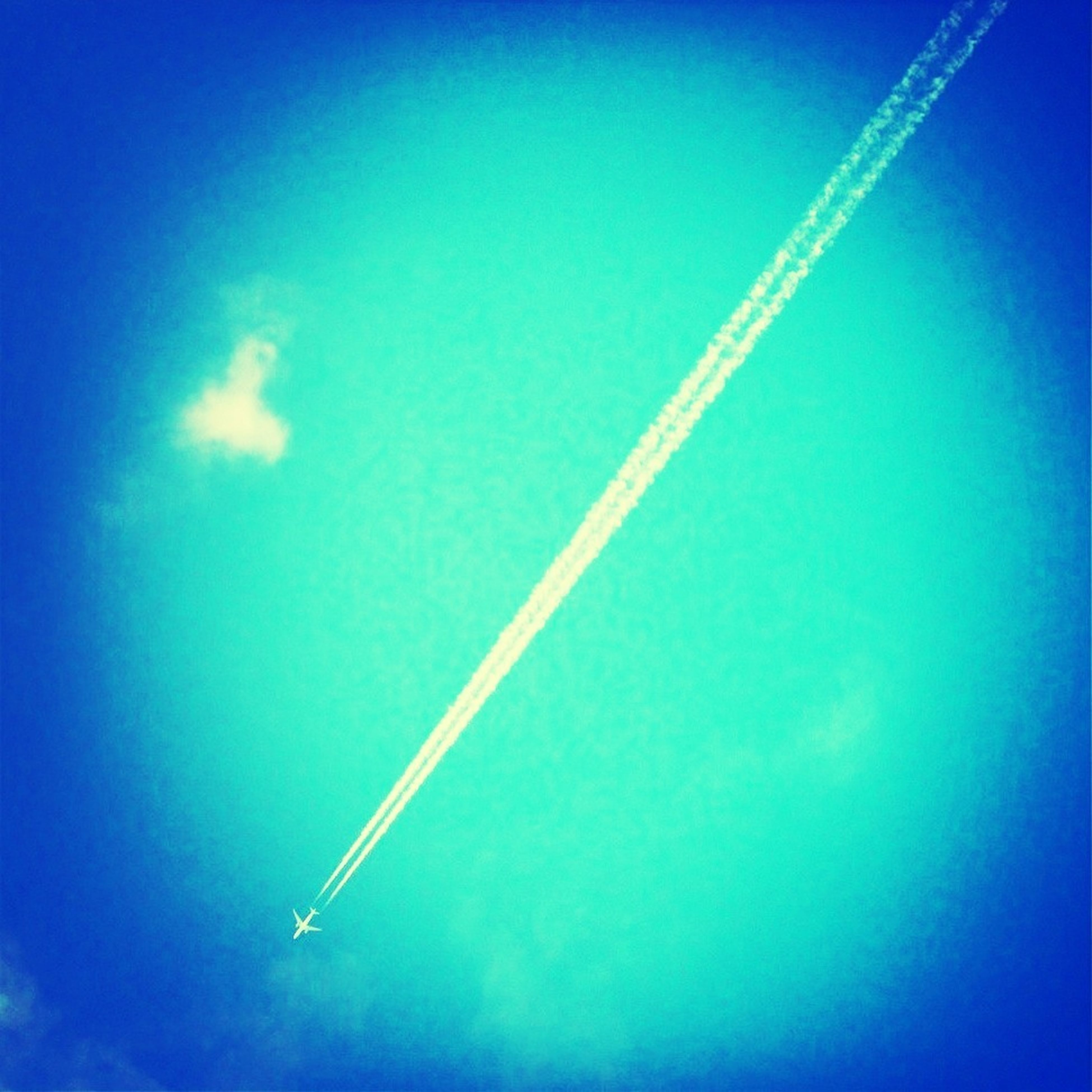 blue, low angle view, flying, vapor trail, transportation, airplane, air vehicle, sky, mode of transport, mid-air, clear sky, copy space, nature, outdoors, no people, on the move, beauty in nature, scenics, travel, day