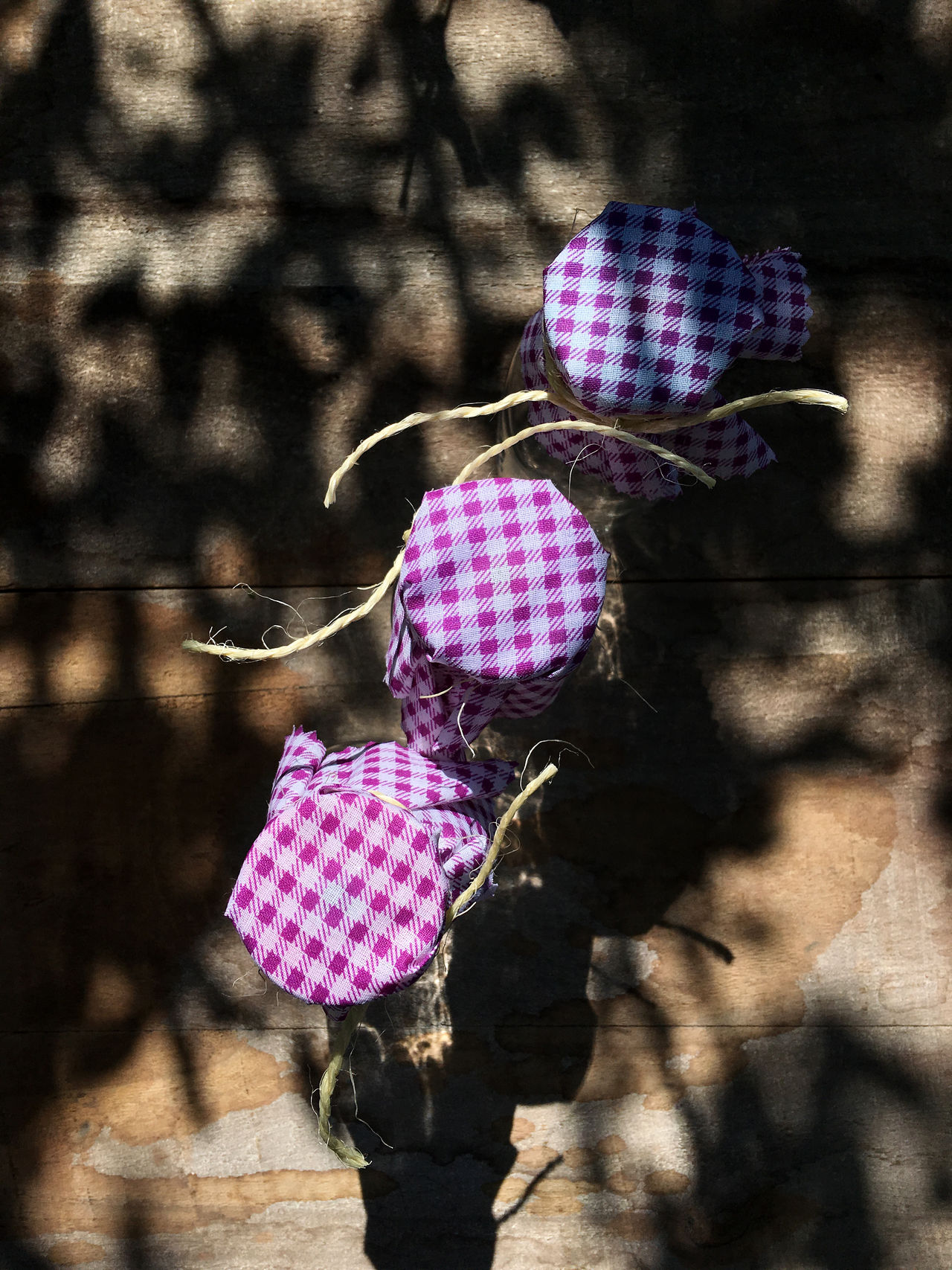 Three Glass Bottles Bottle Checked Pattern Close-up Color Image Day Directly Above Glass - Material Nature No People Outdoors Photography Purple Shabby Chic Shadow Sunlight Table Three Objects Tied Vertical Wood - Material
