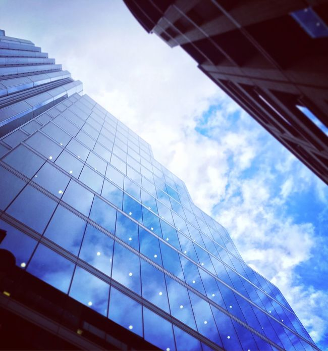 To infinity and beyond Architecture Building Exterior Sky Low Angle View City Modern Cloud - Sky Built Structure Skyscraper No People Day Outdoors Office Block Blue Sky Cloud Blue Urban Landscape Urban Jungle london City New Talent This Week This Week On Eyeem The Street Photographer - 2016 EyeEm Awards London Lifestyle london London