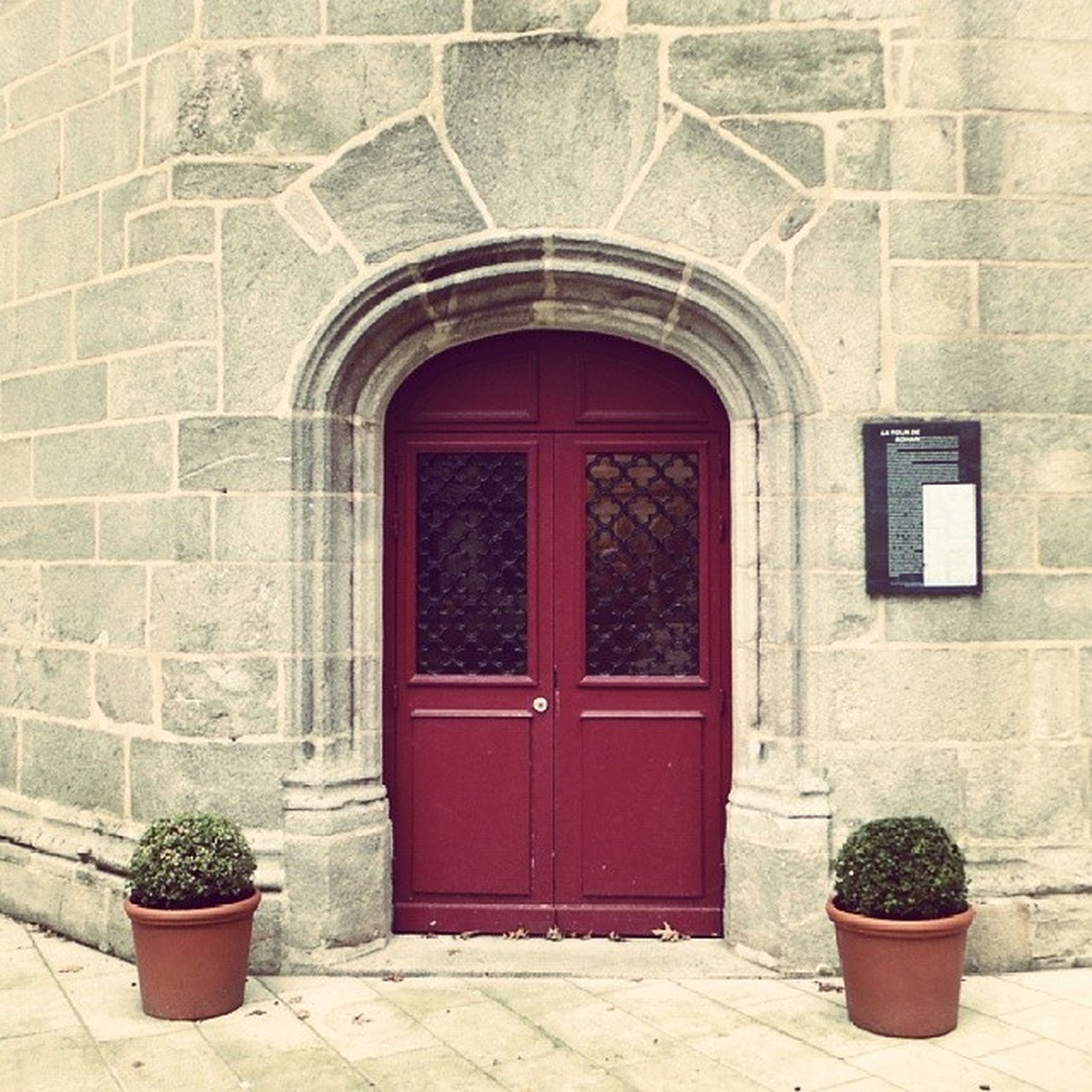 architecture, built structure, building exterior, door, potted plant, closed, red, window, entrance, house, arch, brick wall, wall - building feature, plant, wall, flower pot, day, facade, no people, outdoors