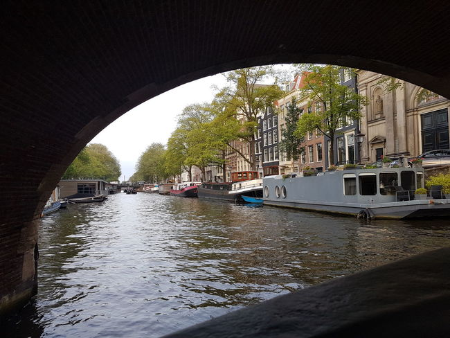 Water Arch Architecture Day No People Outdoors Sunlight River Sun Summer Travel Destinations Travel Tranquility Travel Photography Travelling Amsterdam Canal Amsterdam Canal Vacations