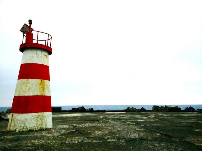 No People Lighthouse Day Red Outdoors Sky Tranquility Building Exterior Built Structure Outside Photography Tranquil Scene Red Direction Beach Sea Portugal Onepluslife Oneplus One OnePlusOne📱 Oneplusonephotography Shotononeplus Outdoor Beauty Beauty In Nature