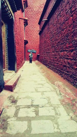 Tibet Built Structure . red Real People Architecture Building Exterior Outdoors Person Day Men One Person
