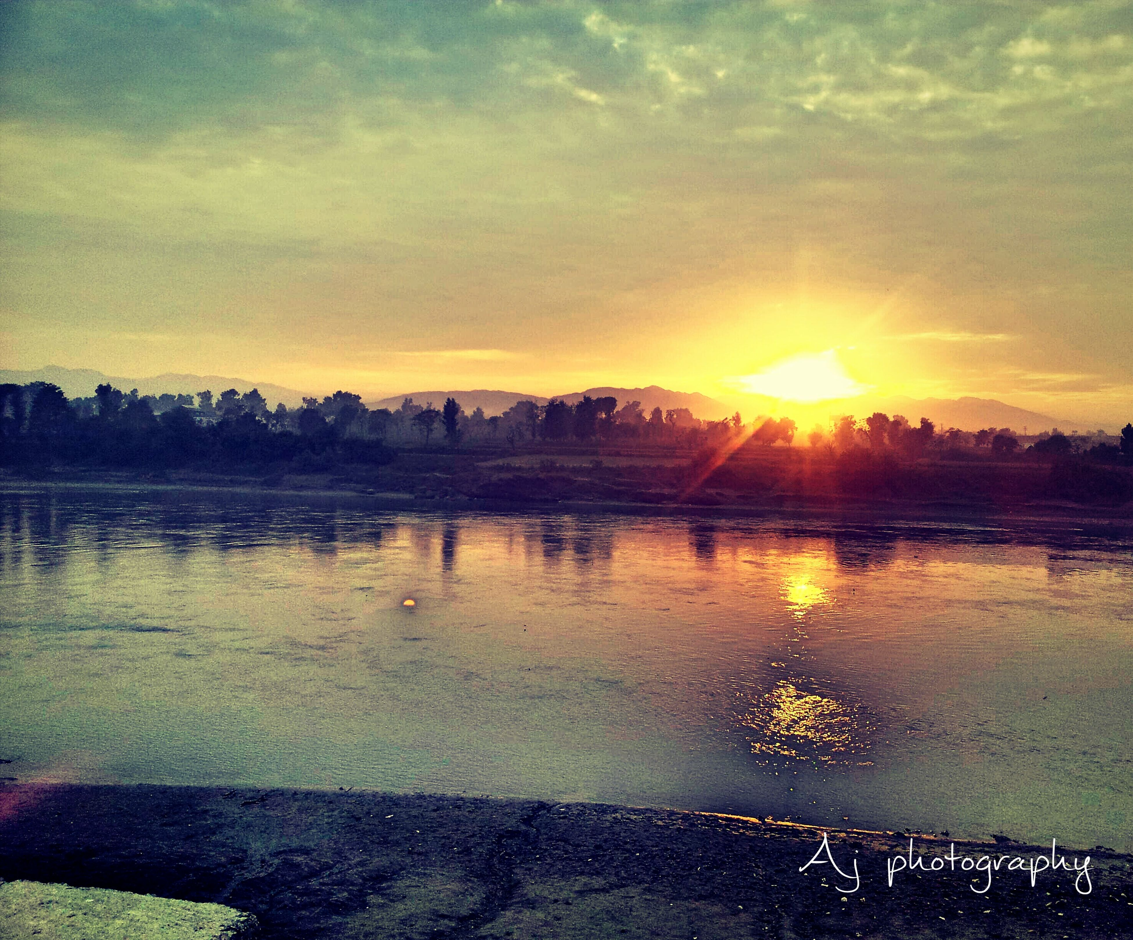 sunset, water, reflection, sun, sky, lake, scenics, beauty in nature, tranquil scene, orange color, cloud - sky, tranquility, nature, sunlight, idyllic, river, sunbeam, outdoors, waterfront, cloud