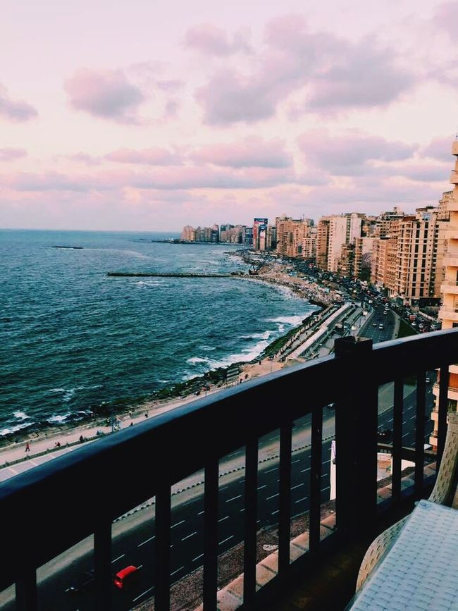 Sea Water Building Exterior Architecture Built Structure City Sky Railing Cityscape Cloud Travel Destinations Cloud - Sky City Life Scenics Coastline Tranquil Scene Wave Day Outdoors Vacations First Eyeem Photo Alexandria Egypt Egypt Mediterranean