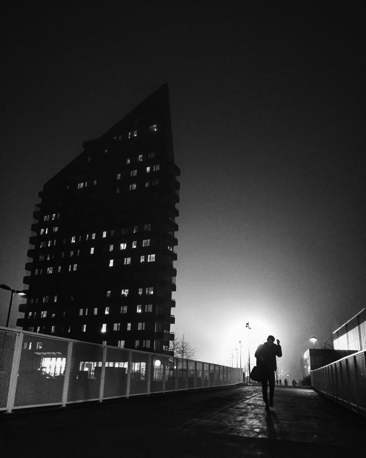 Built Structure City Night Illuminated Skyscraper One Person Monochrome Black And White Street Photography Tranquility Silhouette Bw_collection Darkness And Light