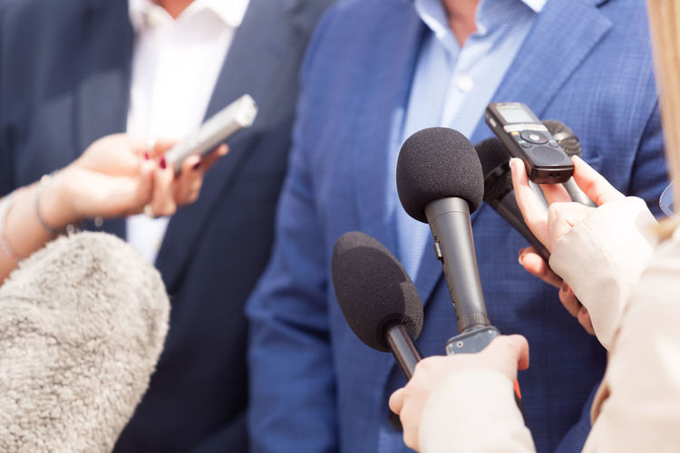 Media interview. News conference. Journalism. Business Event Journalist Politics Reporting Answering Broadcasting Business Person Communication Human Hand Information Journalism Journalist Media Media Interview Microphone News People Politician Press Conference Public Publicity Reporter Speaking