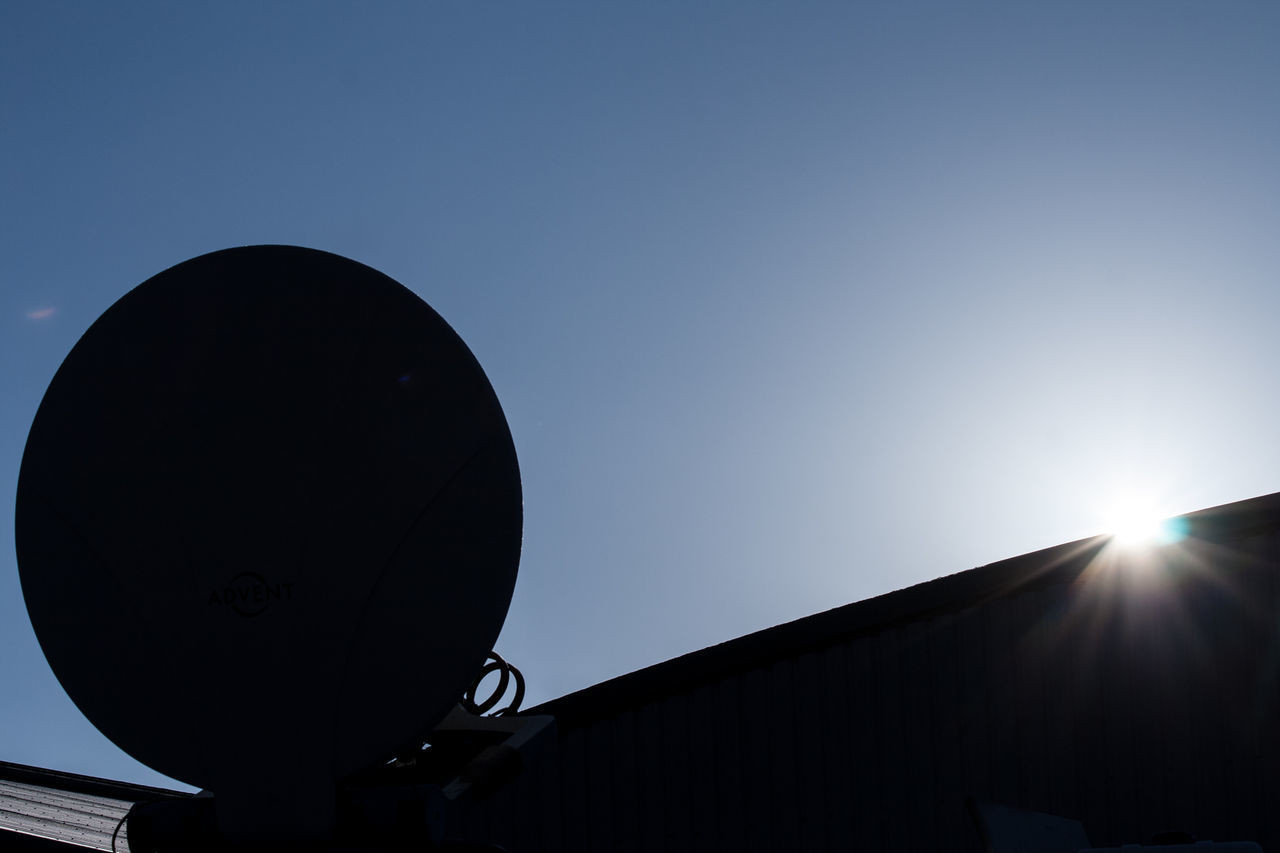 Satellite in the sun. Blue Sky Comunications No Clouds Satellite Satellite Dish Sky No Clouds Sun Glare