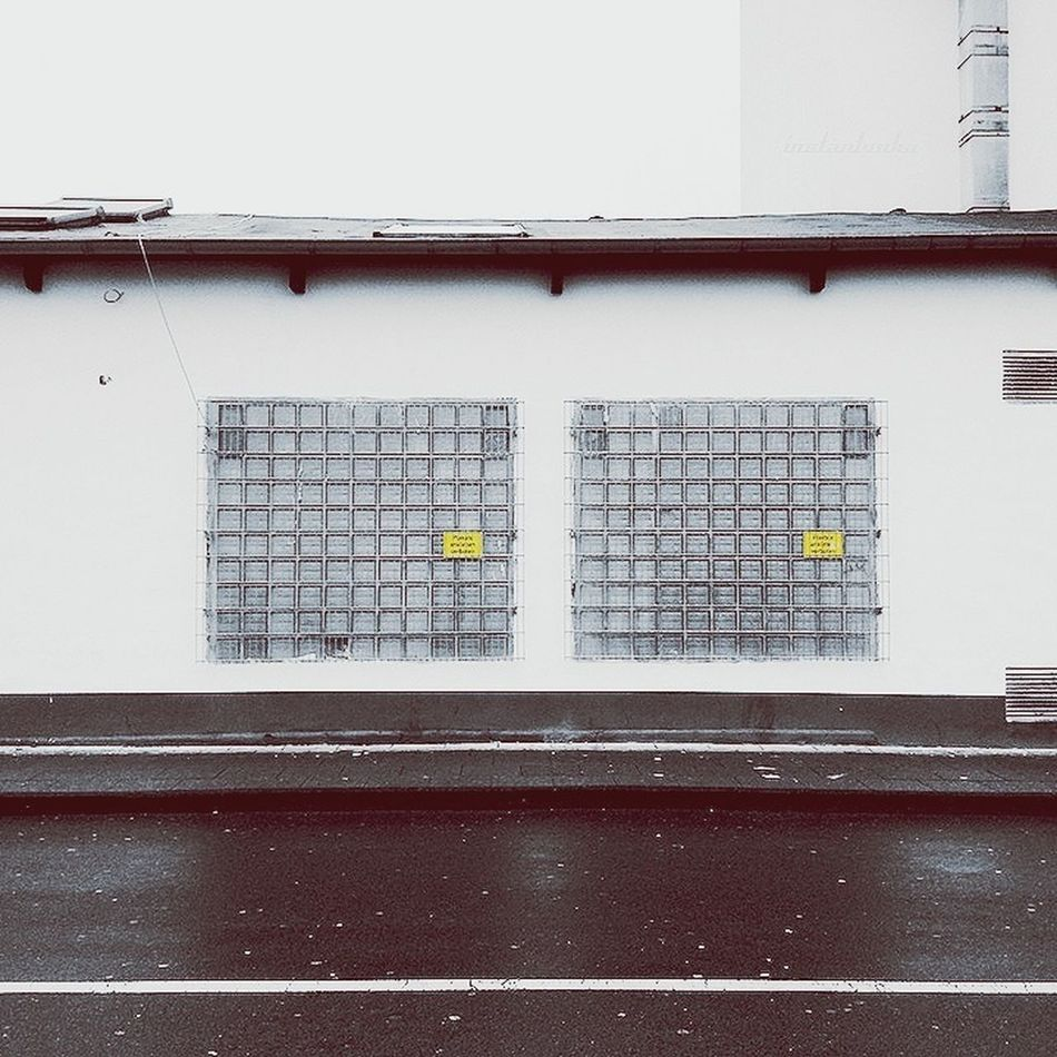 back with 2 Yellow spots Symmetrical Urban Geometry Urban Architecture
