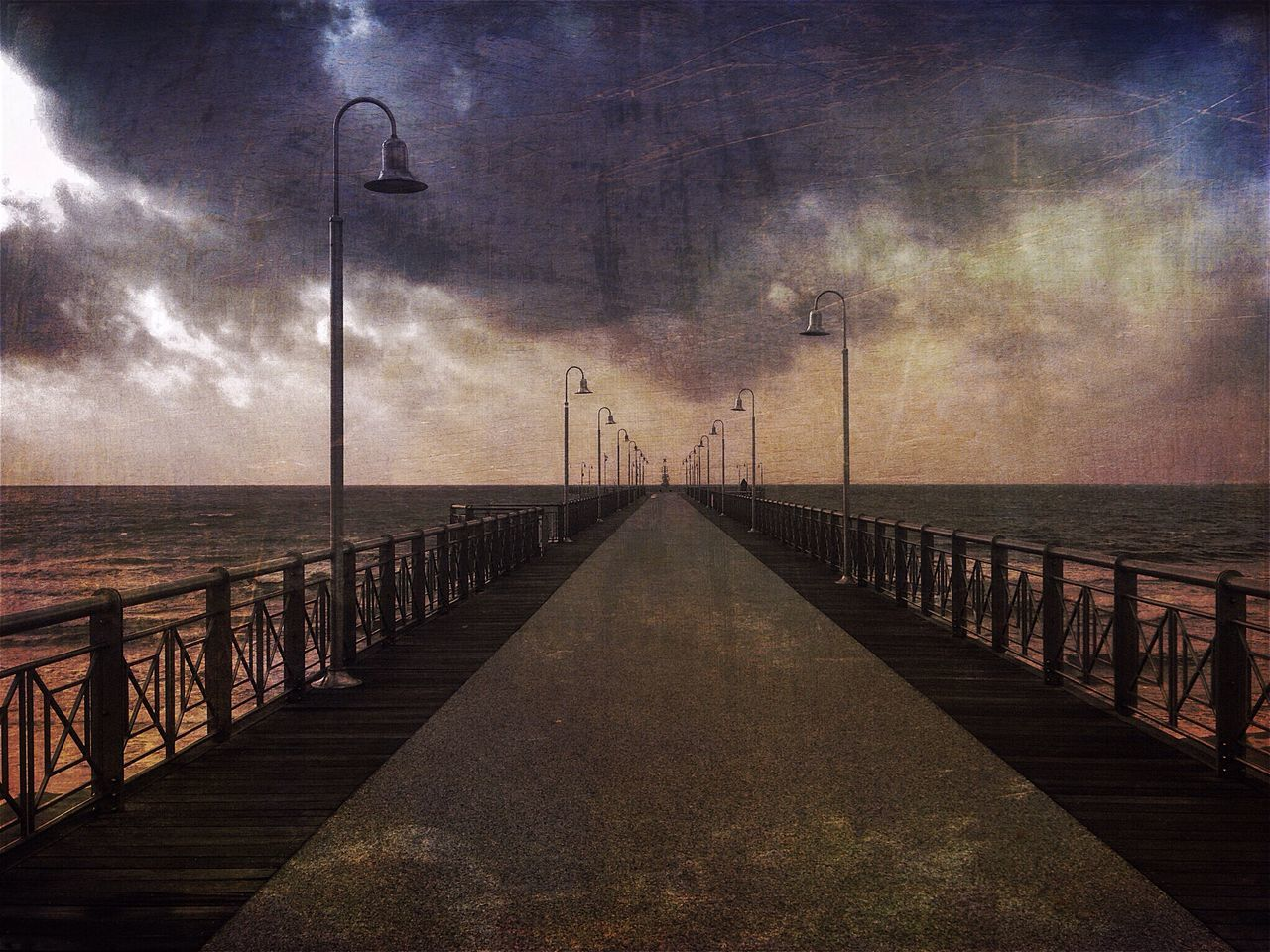 sea, water, horizon over water, tranquil scene, tranquility, pier, sky, the way forward, nature, railing, outdoors, scenics, cloud - sky, beauty in nature, street light, no people, jetty, day, beach