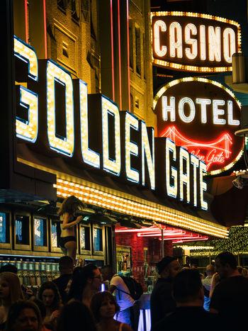 Casino Dancing Gambling Las Vegas Night Life Alcohol Bar City Life Crowd Dancing On The Bar Golden Gate Hotel Illuminated Neon Neon Lights Night Nightlife People Real People Text Travel Destinations Women
