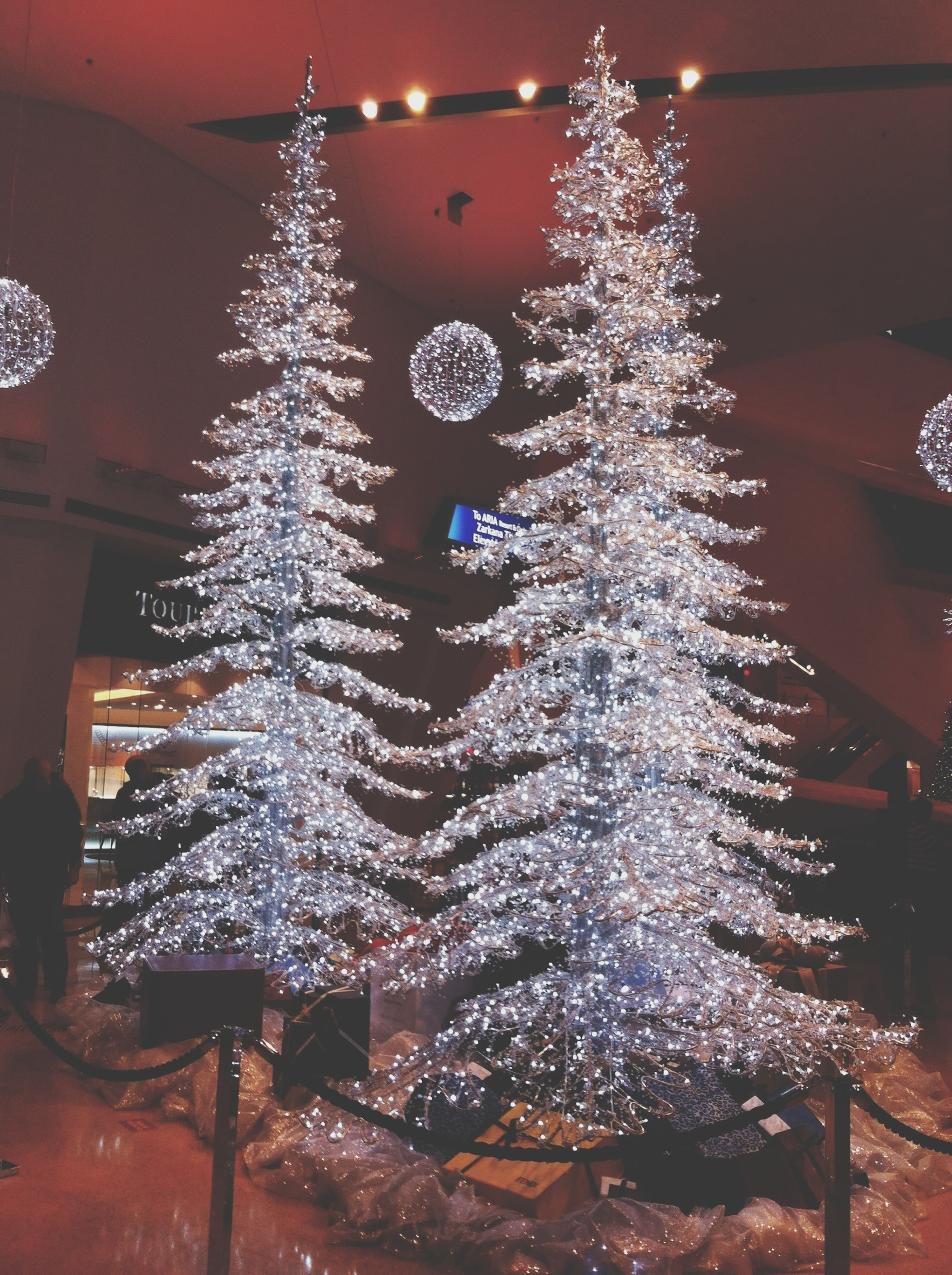 illuminated, decoration, hanging, lighting equipment, night, celebration, tradition, indoors, christmas, christmas decoration, cultures, low angle view, christmas lights, christmas tree, arts culture and entertainment, close-up, glowing, chandelier, no people, motion