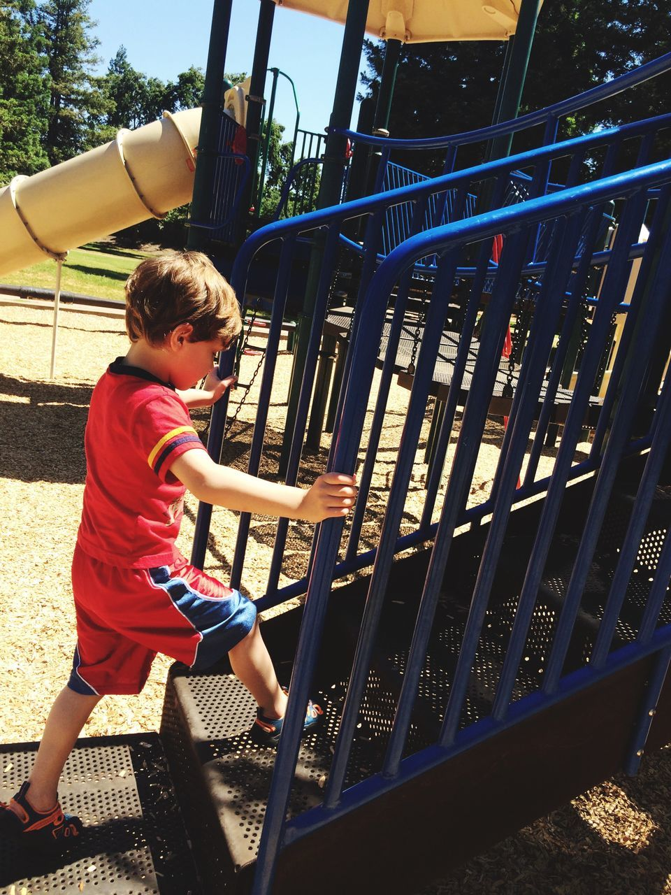 childhood, boys, full length, one person, real people, playground, elementary age, playing, casual clothing, leisure activity, side view, day, outdoors, jungle gym, outdoor play equipment, lifestyles